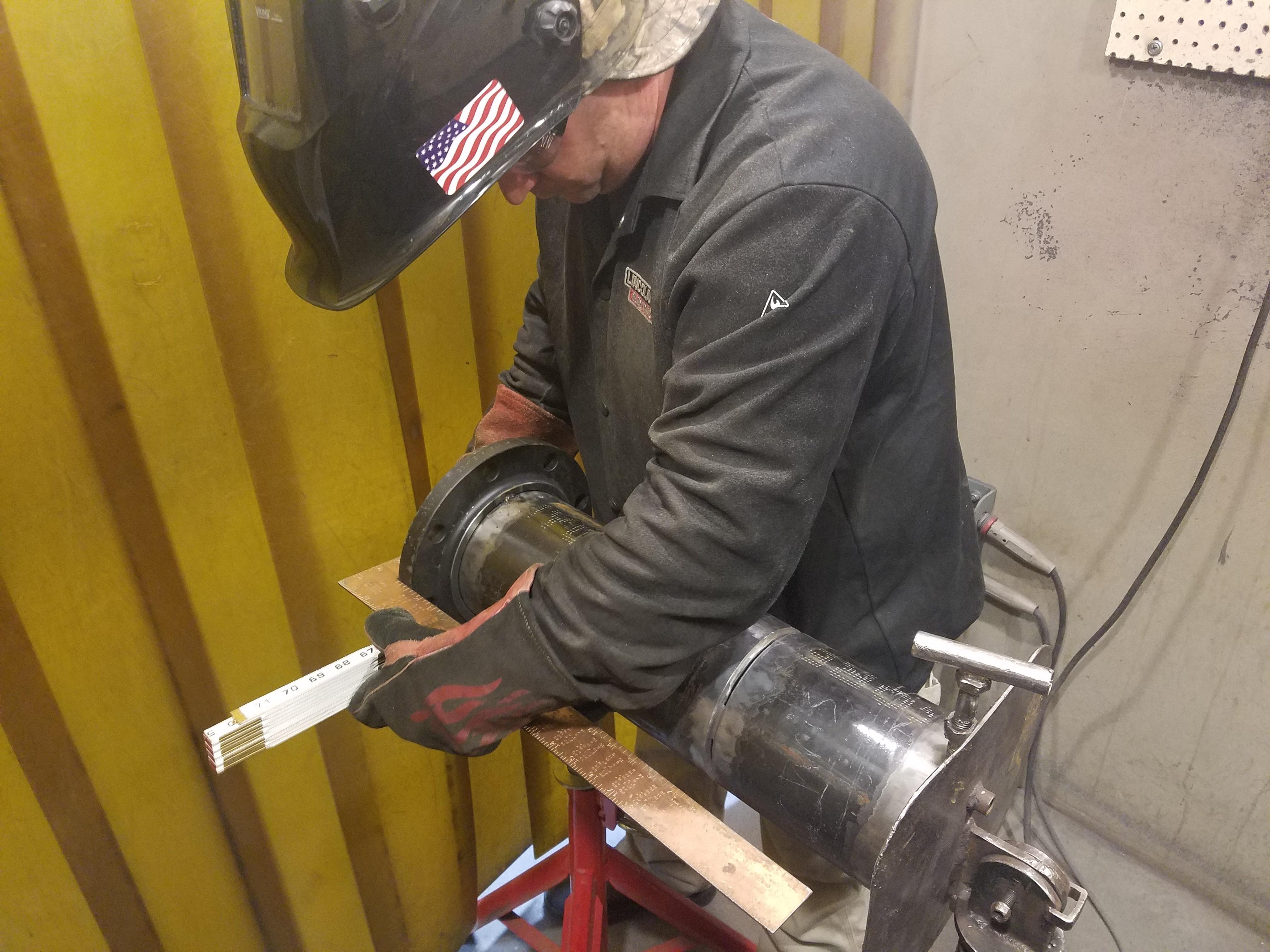 Chris Barnett gains hands-on welding experience through the UA VIP Program at JBLM