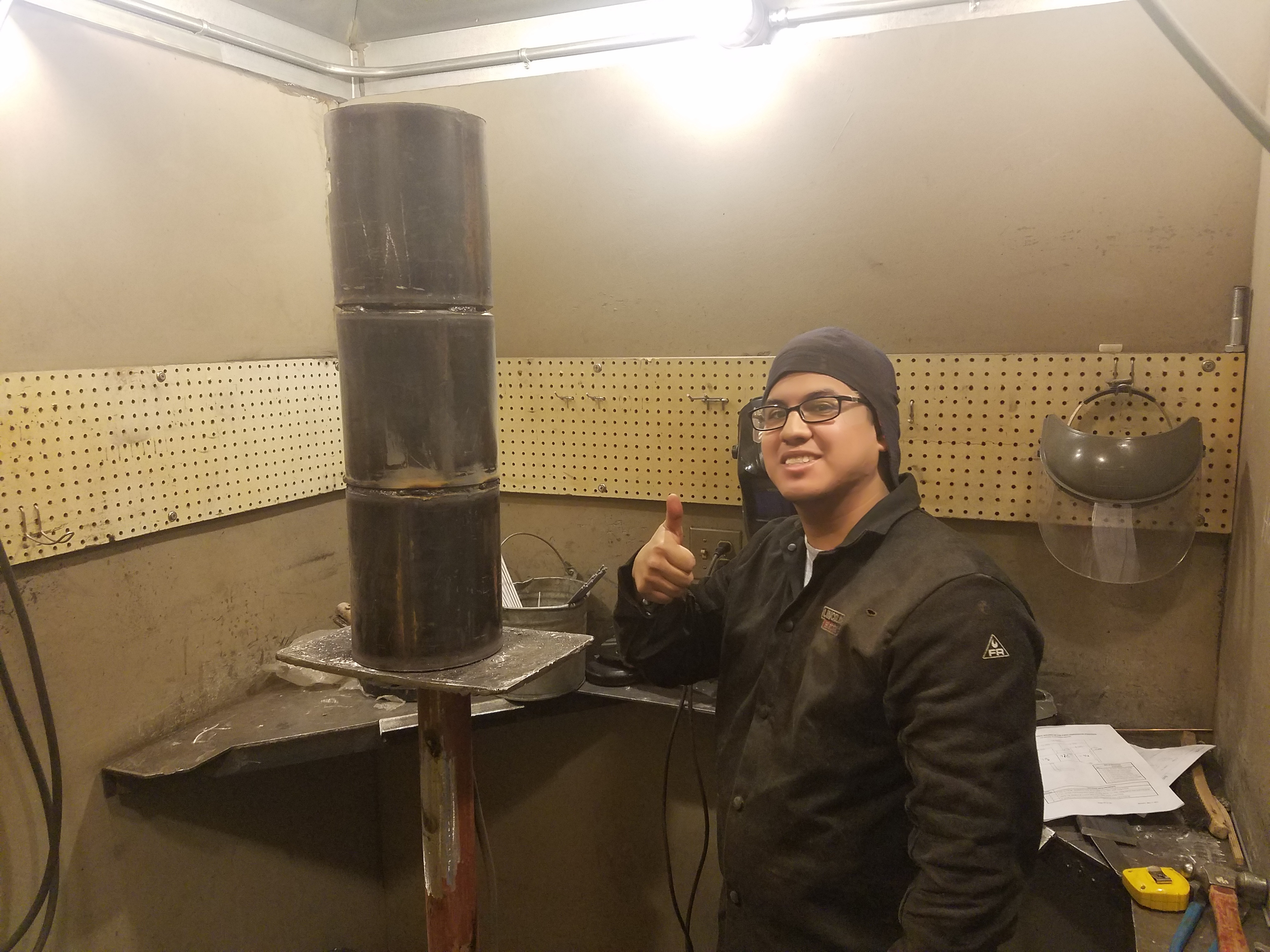 Mark Torres shows his welding project for the UA VIP JBLM Welding Program
