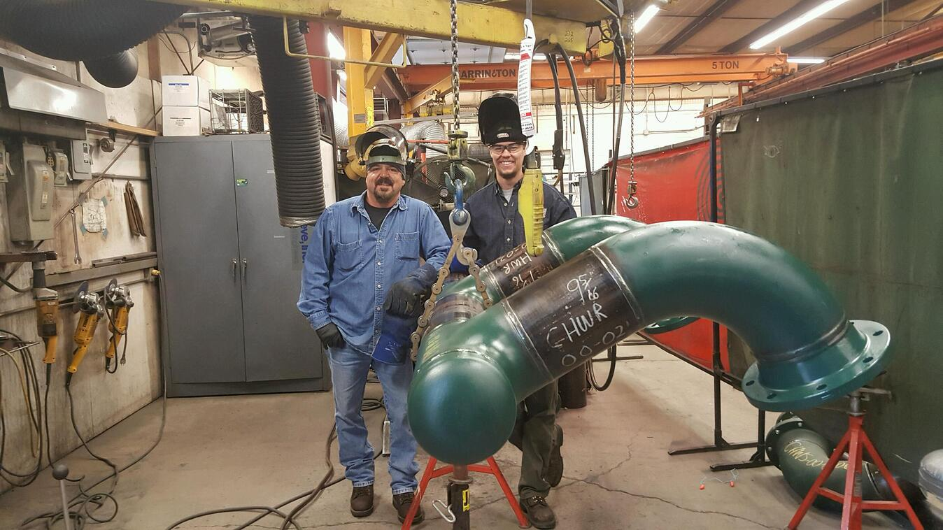 A UA VIP member receives instruction in the welding lab.