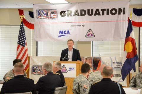 Colorado Gov. John Hickenlooper speaks at a Fort Carson UA VIP graduation ceremony.