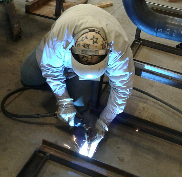 Travis Council tack welding steel frame